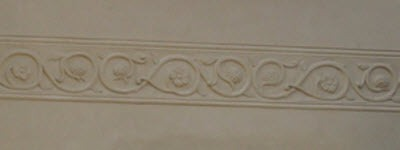 Pargeting on plasterwork of new build house